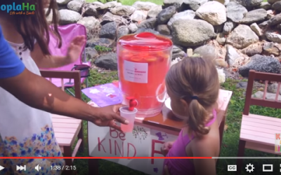 A Lemonade Stand Serving Cups Of Kindness